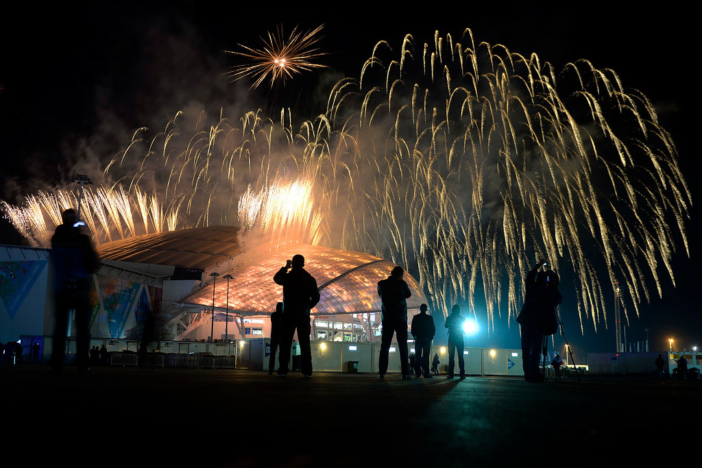 . People watch the fireworks overhead during closing ceremony for the Sochi 2014 Winter Olympics. Sochi 2014 Winter Olympics on Sunday, February 23, 2014 at Fisht Olympic Stadium. (Photo by AAron Ontiveroz/ The Denver Post)