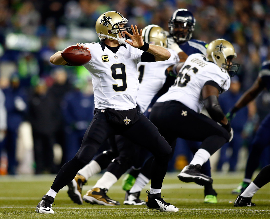 . Quarterback Drew Brees #9 of the New Orleans Saints passes against the Seattle Seahawks during a game at CenturyLink Field on December 2, 2013 in Seattle, Washington.  (Photo by Jonathan Ferrey/Getty Images)