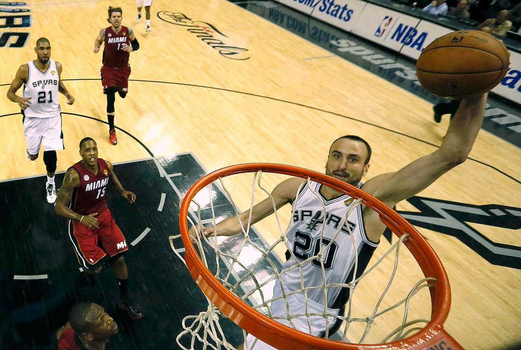 . San Antonio Spurs Manu Ginobili (20) goes up for a slam dunk against the Miami Heat during Game 3 of their NBA Finals basketball series in San Antonio, Texas June 11, 2013. REUTERS/Mike Ehrmann/Pool