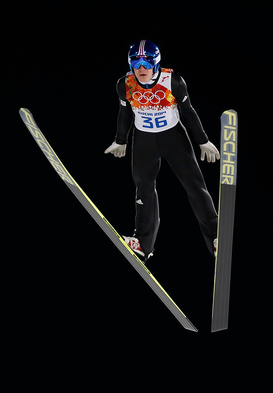 . Slovenia\'s Jurij Tepest makes his trial jump during the men\'s normal hill ski jumping final at the 2014 Winter Olympics, Sunday, Feb. 9, 2014, in Krasnaya Polyana, Russia. (AP Photo/Matthias Schrader)