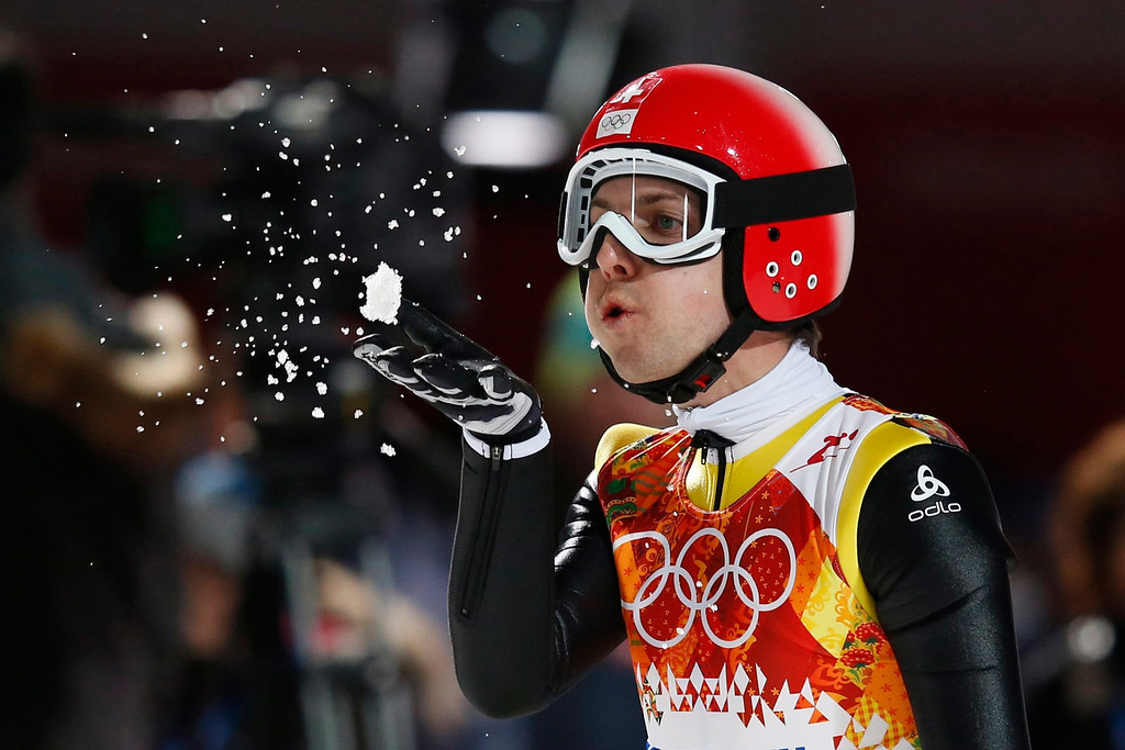 . Simon Ammann of Switzerland reacts after his second jump during the men\'s ski jumping LH competition at the XXII Winter Olympics 2014 Sochi at the RusSki Gorki ski jumping center in Krasnaya Polyana, Russia, 15 February 2014.  EPA/PETER KLAUNZER