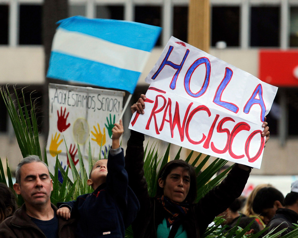 ". A woman holds a sign that reads ""Hello Francis\"" as the faithful gather to watch a televised broadcast of the inaugural mass of Pope Francis near the Metropolitan Cathedral in Buenos Aires March 19, 2013. Pope Francis celebrates his inaugural mass on Tuesday among political and religious leaders from around the world and amid a wave of hope for a renewal of the scandal-plagued Roman Catholic Church.  REUTERS/Marcos Brindicci"