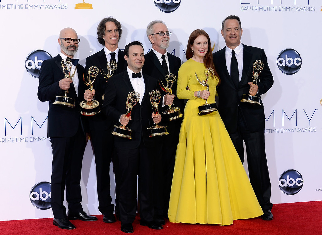 ". (L-R) Producer Steven Shareshian, director Jay Roach, writer Danny Strong, producer Gary Goetzman, actress Julianne Moore, and producer Tom Hanks, winners Outstanding Miniseries or TV Movie for ""Game Change,\"" pose in the press room during the 64th Annual Primetime Emmy Awards at Nokia Theatre L.A. Live on September 23, 2012 in Los Angeles, California.  (Photo by Kevork Djansezian/Getty Images)"