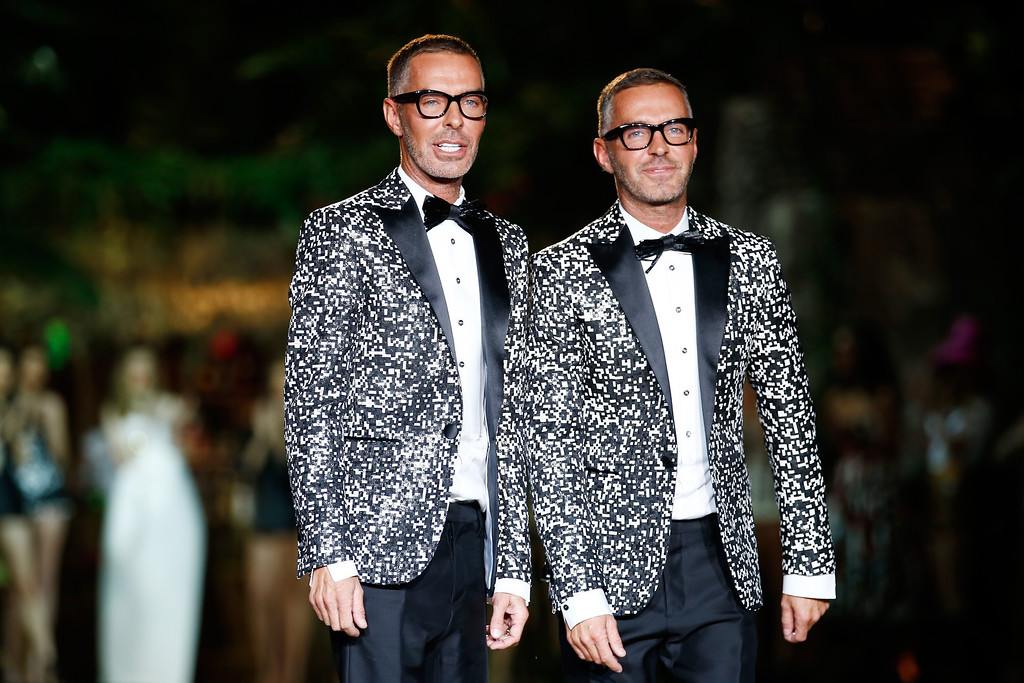 . Designers Dan and Dean Caten aknowledge the applause of the audience on the runway at the DSquared2 show as a part of Milan Fashion Week Womenswear Spring/Summer 2014 on September 18, 2013 in Milan, Italy.  (Photo by Andreas Rentz/Getty Images)