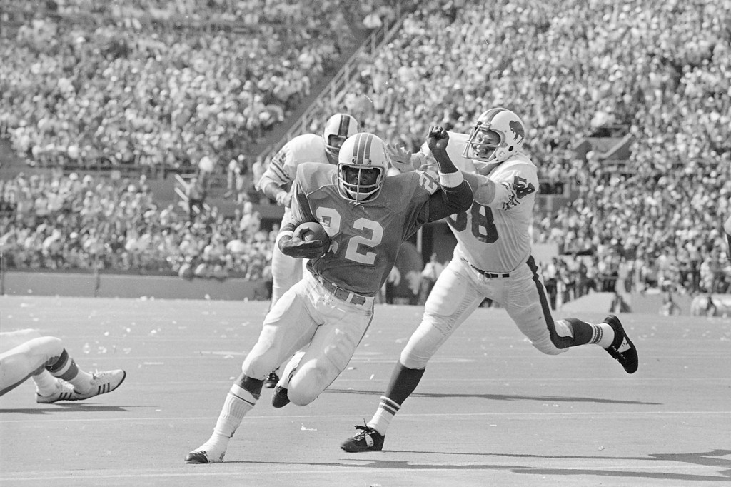 """. Miami Dolphins Eugene \""""Mercury\"""" Morris (22) scores the winning touchdown Sunday, Oct. 23, 1972 in the Orange Bowl against Buffalo Bills as the Dolphins, in their 24-23 win, remain pro football only unbeaten team this season. Trying to stop Morris on his 15 yard jaunt in the fourth quarter is Buffalo\'s Mike Stratton. (AP Photo/Jim  Bourdier)"""
