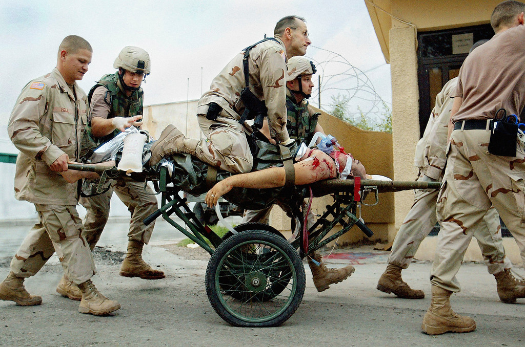 . Combat Support Hospital Army Nurse supervisor Patrick McAndrew tries to save the life of an American soldier by giving him CPR upon arrival at the Combat Support Hospital in Baghdad, Iraq on April 4, 2005. (AP Photo/John Moore)