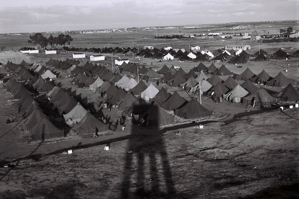 . BEIT LID, ISRAEL - DECEMBER 1, 1949: A guard tower throws a long afternoon shadow over a new immigrants\' camp December 1, 1949 at Beit Lid in the newly-established State of Israel. (Photo by Zoltan Kluger/GPO via Getty Images)