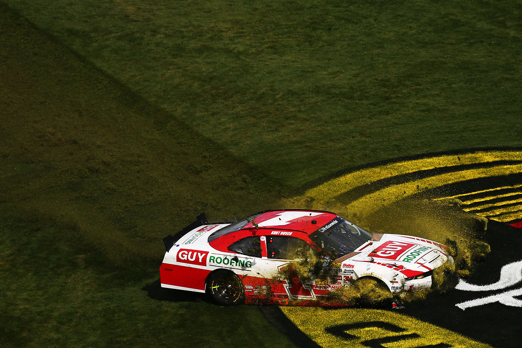 . DAYTONA BEACH, FL - FEBRUARY 23:  Kurt Busch, driver of the #1 Guy Roofing Chevrolet, spins out after an incident during the NASCAR Nationwide Series DRIVE4COPD 300 at Daytona International Speedway on February 23, 2013 in Daytona Beach, Florida.  (Photo by Jonathan Ferrey/Getty Images)