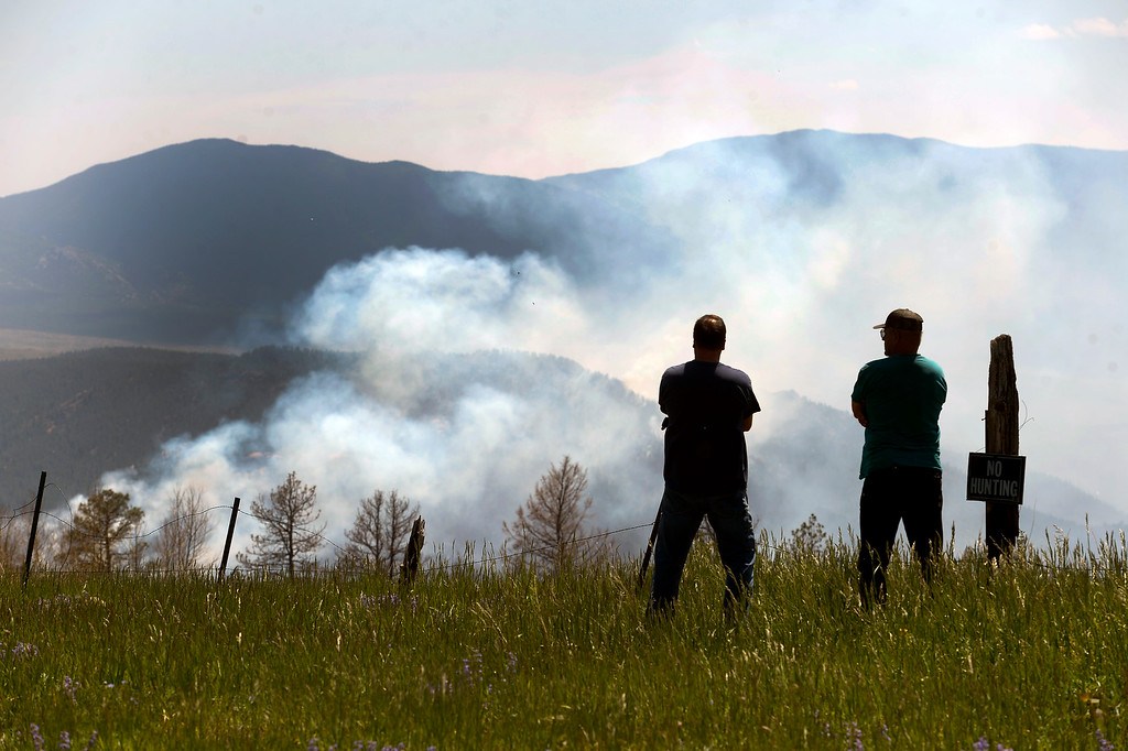 . JEFFERSON COUNTY, CO - JUNE 20:  Home owners  Scott Magnuson, left and Bill Morfe, watch the Lime Gulch Fire from the vantage point of Kuehster Road in Jefferson County on June 20, 2013. The Lime Gulch Fire which is burning off of Foxton Road near Conifer, CO continues to burn almost next to last year\'s Lower North Fork fire on June 20, 2013.  Kuehster Road is where many homes burned in the Lower North Fork Fire in March of 2012.  Photo by Helen H. Richardson/The Denver Post)