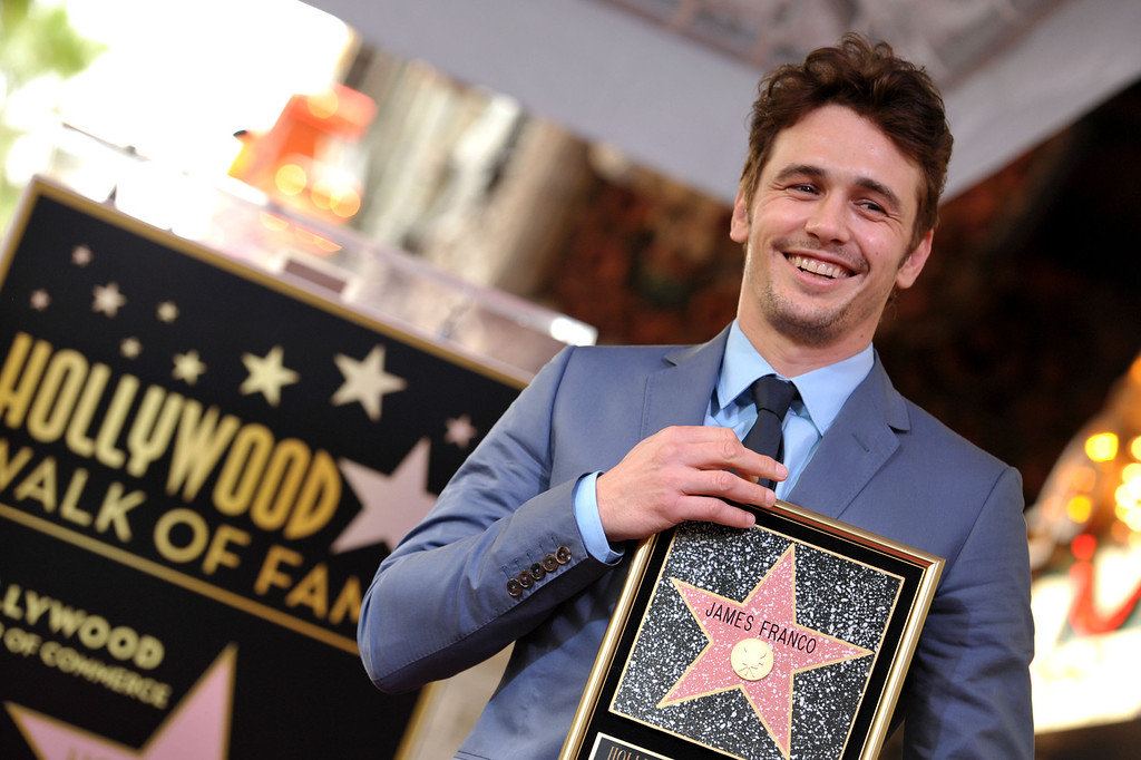 . Actor James Franco poses with his new star at a ceremony honoring him on the Hollywood Walk of Fame on Thursday, March 7, 2013 in Los Angeles. (Photo by John Shearer/Invision/AP)