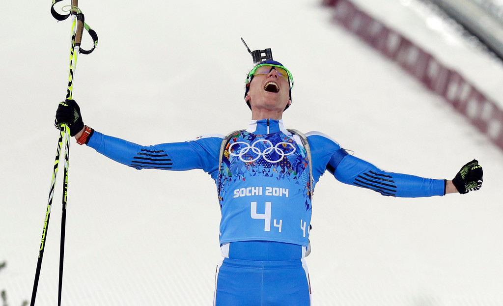 . Italy\'s Lukas Hofer celebrates winning the bronze medal in the mixed biathlon relay at the 2014 Winter Olympics, Wednesday, Feb. 19, 2014, in Krasnaya Polyana, Russia. (AP Photo/Kirsty Wigglesworth)