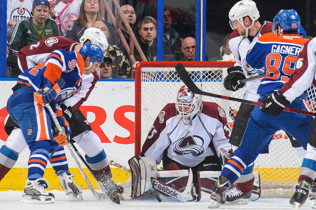 . Ryan Smyth #94 of the Edmonton Oilers takes a shot on Jean-Sebastien Giguere #35 of the Colorado Avalanche during an NHL game at Rexall Place on April 8, 2014 in Edmonton, Alberta, Canada. (Photo by Derek Leung/Getty Images)