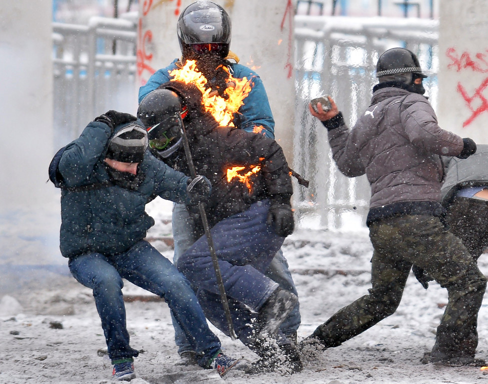. Protesters clash with the police in the center of Kiev on January 22, 2014. Ukrainian police on Wednesday stormed protesters\' barricades in Kiev as violent clashes erupted and activists said that one person had been shot dead by the security forces. Total of two activists shot dead during clashing. The move by police increased tensions to a new peak after two months of protests over President Viktor Yanukovych\'s failure to sign a deal for closer ties with the EU. AFP PHOTO/ SERGEI SUPINSKY/AFP/Getty Images