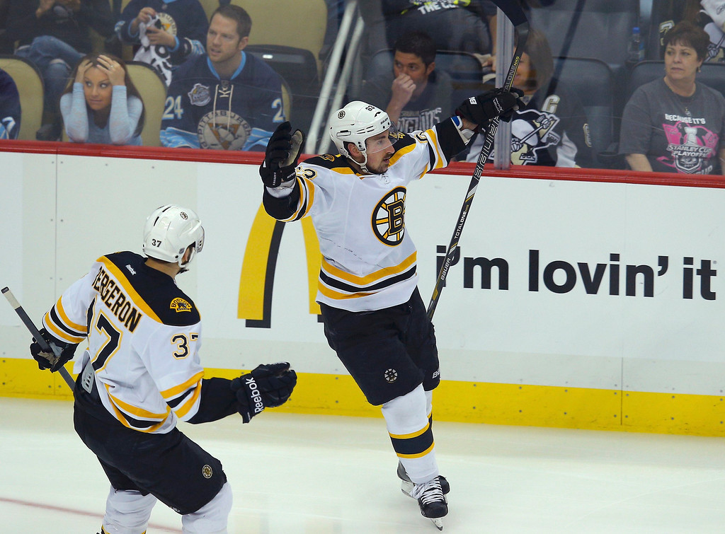 . Boston Bruins left wing Brad Marchand celebrates his first period goal against the Pittsburgh Penguins with teammates Patrice Bergeron (37) in Game 2 of their NHL Eastern Conference finals hockey playoff series in Pittsburgh, Pennsylvania, June 3, 2013.  REUTERS/Brian Snyder