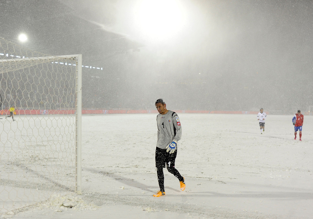 . COMMERCE CITY, CO. - MARCH 22: Costa Rica goalkeeper Keilor Navas (1) headed to the locker room at halftime as weather conditions deteriorated. The U.S. Men\'s National Soccer Team hosted Costa Rica Friday night, March 22, 2013 in a FIFA World Cup qualifier at Dick\'s Sporting Goods Park in Commerce City.  (Photo By Karl Gehring/The Denver Post)
