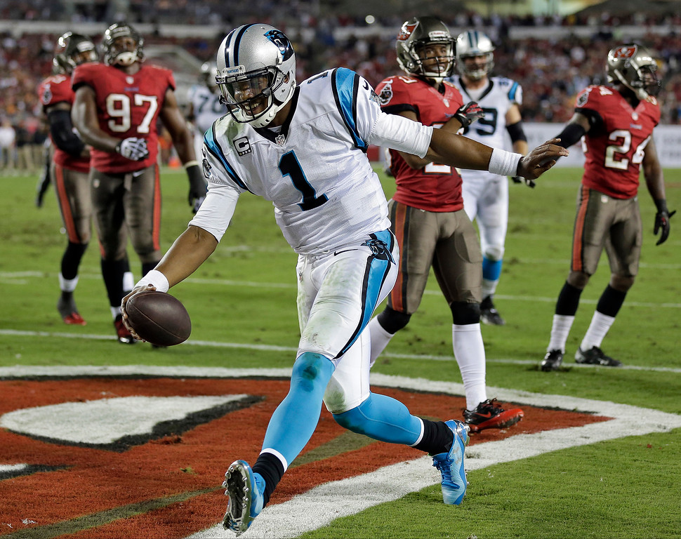 . Carolina Panthers quarterback Cam Newton (1) celebrates after scoring on a 6-yard touchdown run against the Tampa Bay Buccaneers during the third quarter of an NFL football game on Thursday, Oct. 24, 2013, in Tampa, Fla. (AP Photo/Chris O\'Meara)