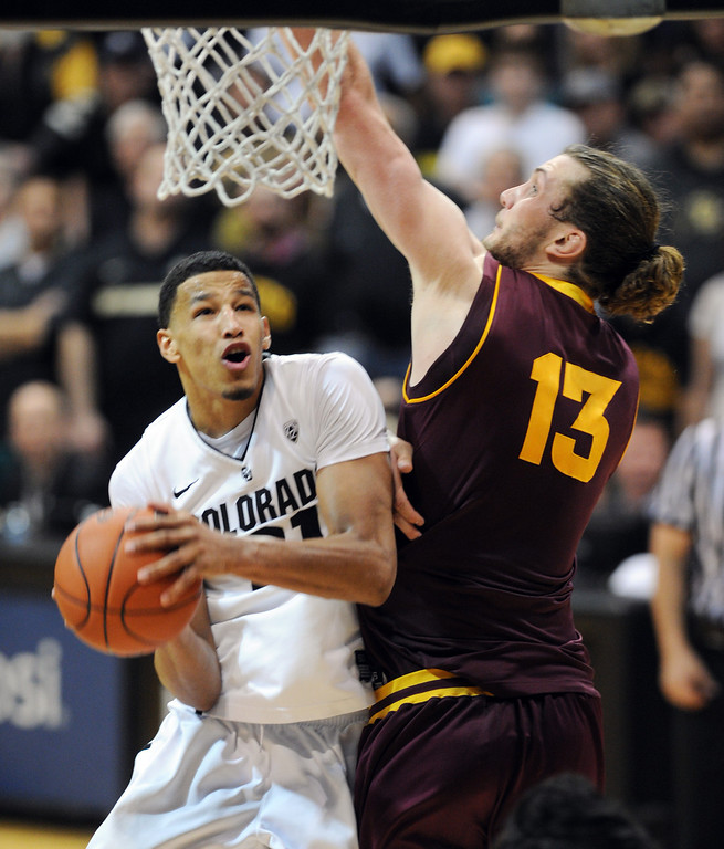 . Andre Roberson tries to score on Jordan Bachynski of ASU during the second half of the February 16th, 2013 game in Boulder. Cliff Grassmick / February 16, 2013