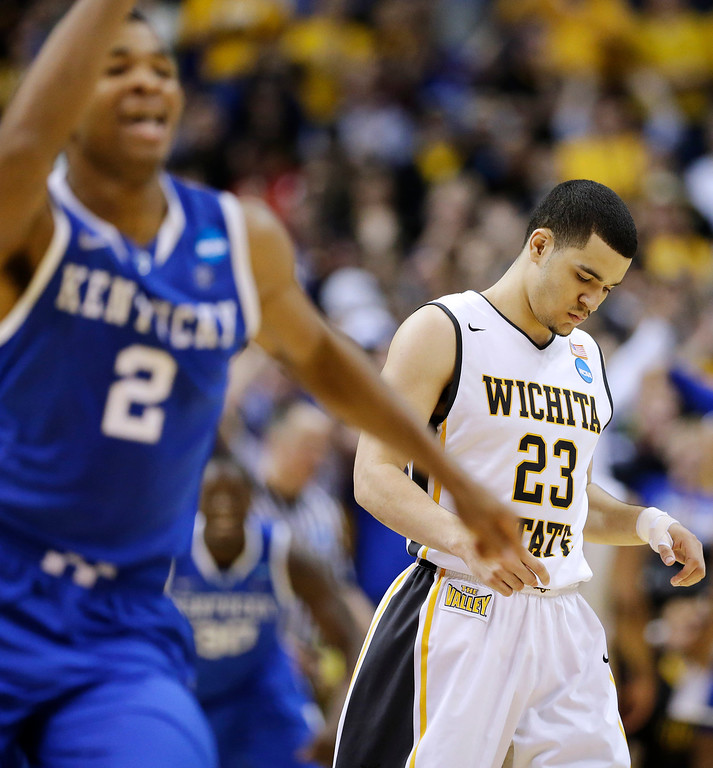 . Wichita State guard Fred VanVleet (23) leaves the floor after missing a three-point attempt in the final seconds against Kentucky  during the second half of a third-round game of the NCAA college basketball tournament Sunday, March 23, 2014, in St. Louis. Kentucky won 78-76. (AP Photo/Charlie Riedel)