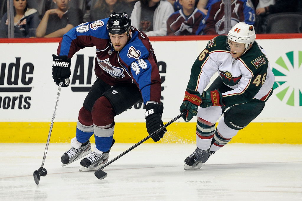 . Ryan O\'Reilly (90) of the Colorado Avalanche fends off Jared Spurgeon (46) of the Minnesota Wild as he carries the puck into the zone during the third period, Saturday, April 27, 2012 at Pepsi Center. Seth A. McConnell, The Denver Post