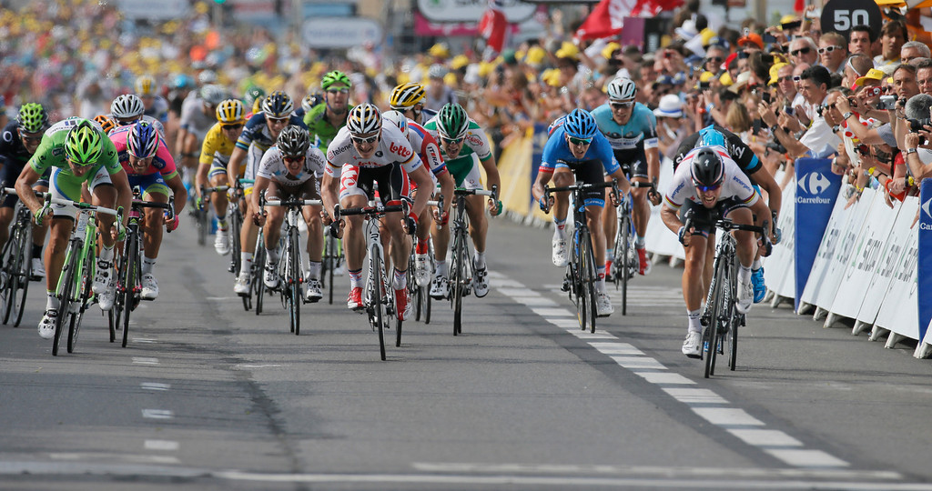 . Britain\'s Marc Cavendish, far right in white, sprints towards the finish line ahead of Edvald Boasson Hagen of Norway, second place, right behind Cavendish, Peter Sagan of Slovakia, third place, far left, and Andre Greipel of Germany, center and fourth place, to win the fifth stage of the Tour de France cycling race over 228.5 kilometers (142.8 miles) with start in Cagnes-sur-Mer and finish in Marseille, southern France, Wednesday July 3, 2013. (AP Photo/Laurent Rebours)