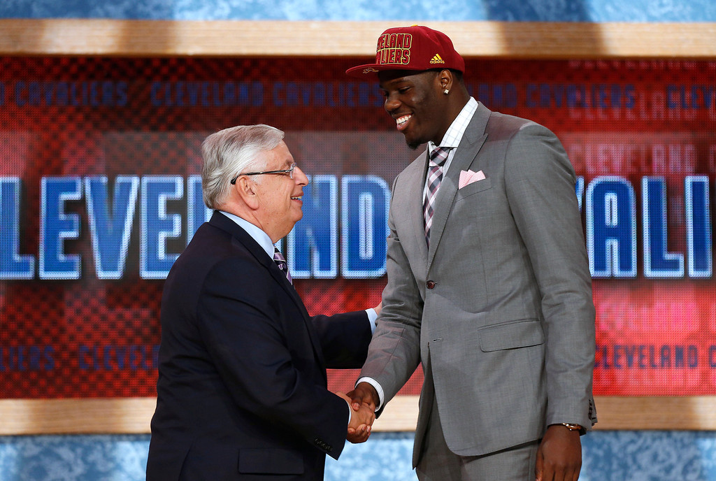 . NBA Commissioner David Stern, left, shakes hands with UNLV\'s Anthony Bennett, who was selected first overall by the Cleveland Cavaliers in the NBA basketball draft, Thursday, June 27, 2013, in New York. (AP Photo/Jason DeCrow)