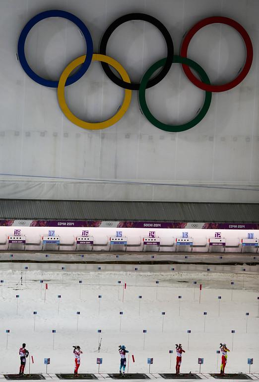 . Athletes shoot during the women\'s biathlon 12.5k mass-start, at the 2014 Winter Olympics, Monday, Feb. 17, 2014, in Krasnaya Polyana, Russia. (AP Photo/Gero Breloer)