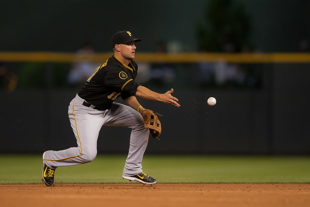 . Jordy Mercer #10 of the Pittsburgh Pirates tosses underhand for a force out at second base in the eighth inning of a game against the Colorado Rockies at Coors Field on July 26, 2014 in Denver, Colorado. (Photo by Dustin Bradford/Getty Images)