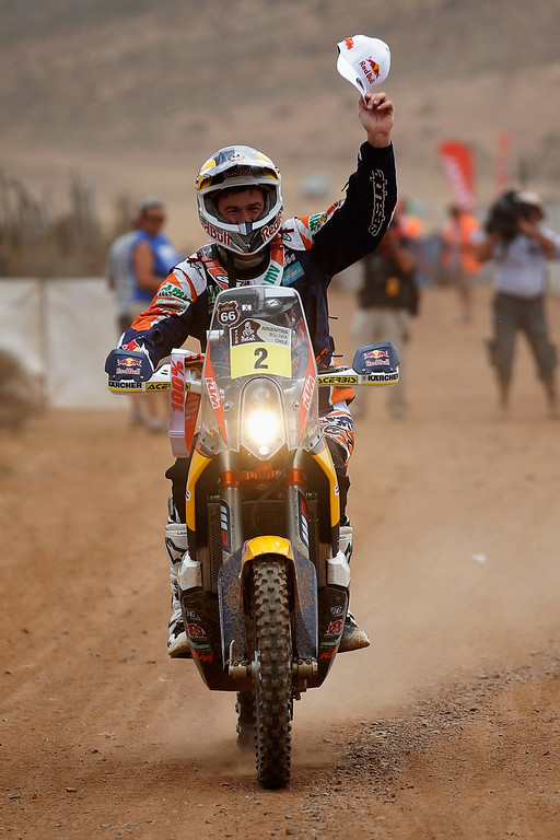. ILLAPEL, CHILE - JANUARY 18:  (#2)  Marc Coma of Spain for the KTM Red Bull Rally Factory Team celebrates on the finish line after winnng the 2014 Dakar Rally on January 18, 2014 in Illapel, Chile.  (Photo by Dean Mouhtaropoulos/Getty Images)