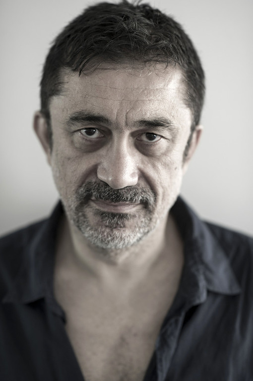 . (EDITORS NOTE: This image has been retouched)  Director Nuri Bilge Ceylan poses during the Winter Sleep portrait session held at the Turkish Pavilion on May 15, 2014 in Cannes, France.  (Photo by Gareth Cattermole/Getty Images)