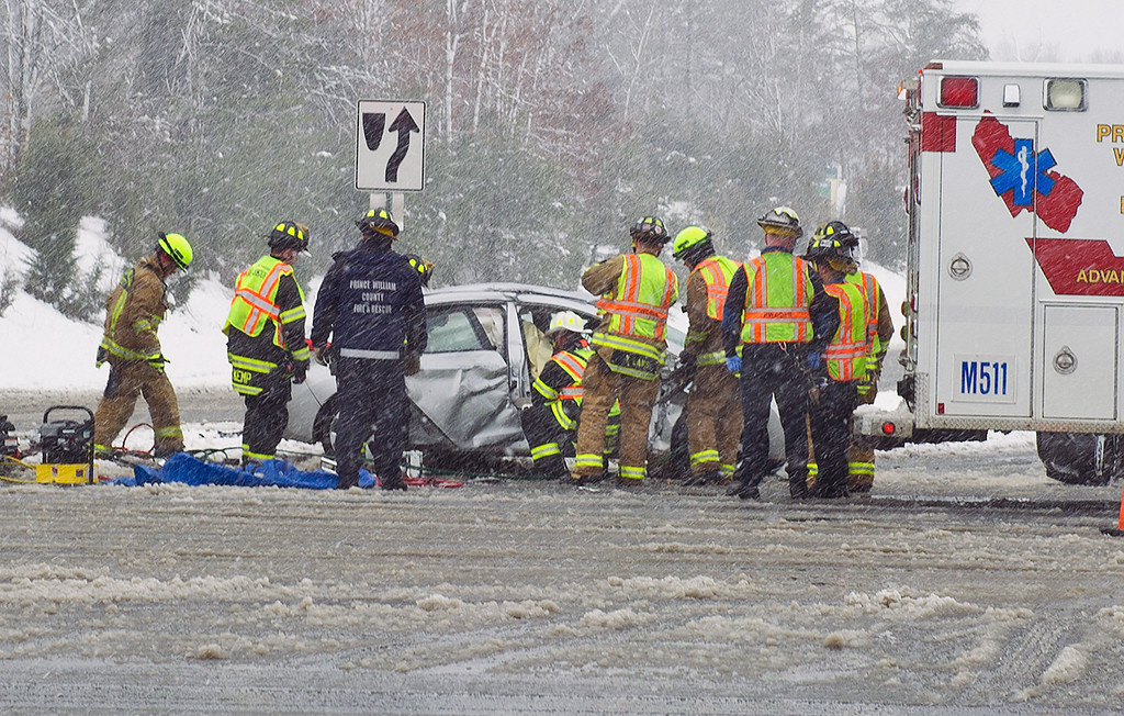 . Prince William County rescue squads work to help a car accident victim out of the wreckage March 6, 2013 in Prince William Coutny, Virginia. The accident was likely caused by icy conditions and blowing snow due to the winter storm on the East coast.AFP PHOTO/Karen  BLEIER/AFP/Getty Images
