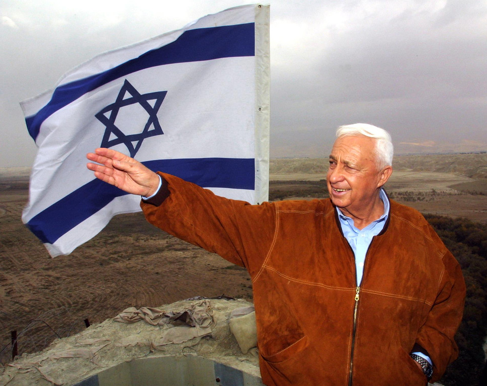 . Israeli right-wing opposition leader Ariel Sharon gestures during a visit to an army lookout in Tovlan in the Jordan valley 03 January 2001.  AFP PHOTO/PHILIPPE  DESMAZES/AFP/Getty Images