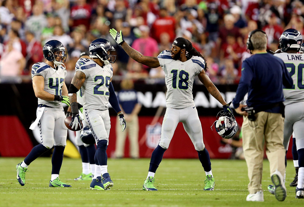 . GLENDALE, AZ - OCTOBER 17: Free safety Earl Thomas #29 and wide receiver Sidney Rice #18 of the Seattle Seahawks react after a defensive play against the Arizona Cardinals during a game at the University of Phoenix Stadium on October 17, 2013 in Glendale, Arizona.  (Photo by Christian Petersen/Getty Images)