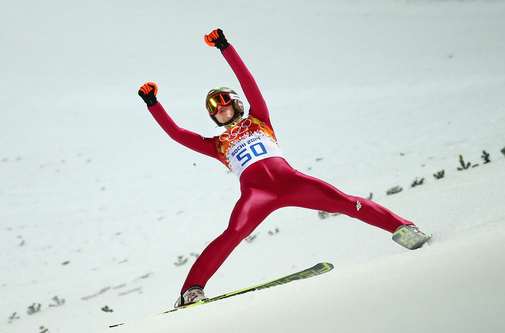 . SOCHI, RUSSIA - FEBRUARY 09:  Kamil Stoch of Poland celebrates as he claims the Gold Medal during the Men\'s Normal Hill Individual Ski Jumping Final on day 2 of the Sochi 2014 Winter Olympics at RusSki Gorki Jumping Center on February 9, 2014 in Sochi, Russia.  (Photo by Ryan Pierse/Getty Images)