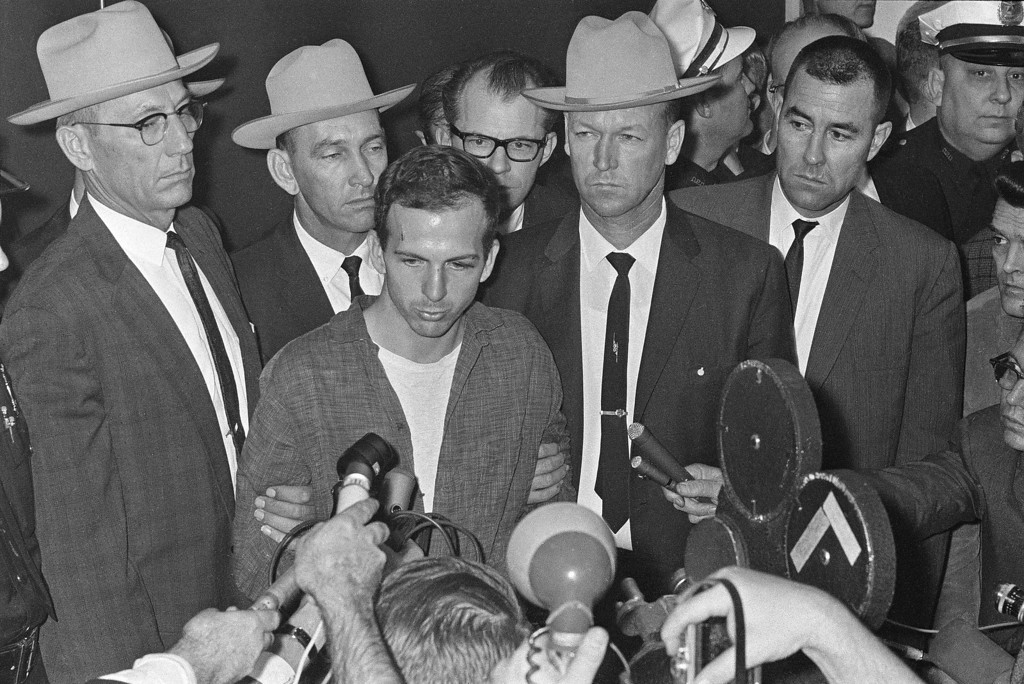 """. Oswald faces the media in a Dallas police station, where he repeatedly denied he had assassinated the president the previous day.  \""""I did not kill President Kennedy,\"""" he said. \""""I did not kill anyone. I don\'t know what this is all about.\"""" He was brought before the press  after formal charges of murder were filed against him.   Associated Press file"""