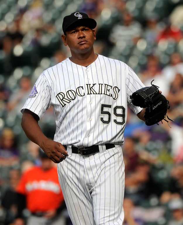 . Colorado reliever Wilton Lopez reacted after allowing a Donovan Solano home run in the ninth inning. The Colorado Rockies were defeated by the Miami Marlins 5-3 at Coors Field Thursday afternoon, July 25, 2013. Photo By Karl Gehring/The Denver Post