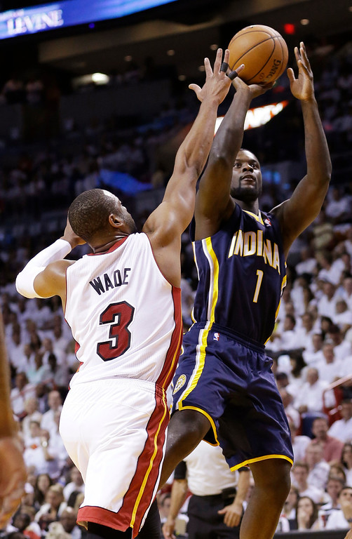 . Indiana Pacers guard Lance Stephenson (1) aims for the basket as Miami Heat guard Dwyane Wade (3) defends, during the first half of Game 4 in the NBA basketball Eastern Conference finals playoff series, Monday, May 26, 2014, in Miami. (AP Photo/Wilfredo Lee)