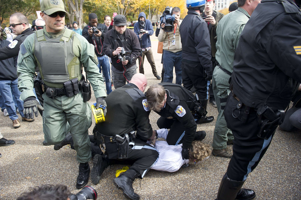 . US Park Police arrest a protestor during a march against corrupt governments and corporations organized by supporters of the group Anonymous, in front of the White House in Washington, DC, November 5, 2013, as part of a Million Mask March of similar rallies around the world on Guy Fawkes Day. AFP PHOTO / Saul  LOEB/AFP/Getty Images