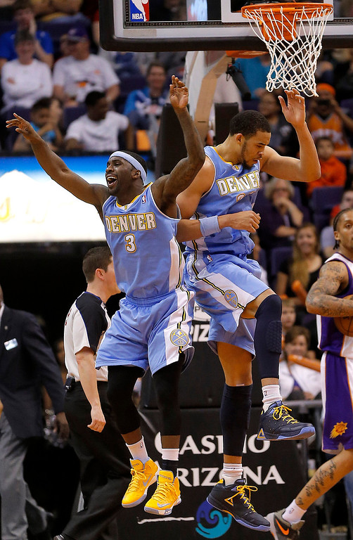 . Denver Nuggets\' Ty Lawson (3) and JaVale McGee celebrate against the Phoenix Suns during the second half of an NBA basketball game, Monday, March 11, 2013, in Phoenix.  (AP Photo/Matt York)