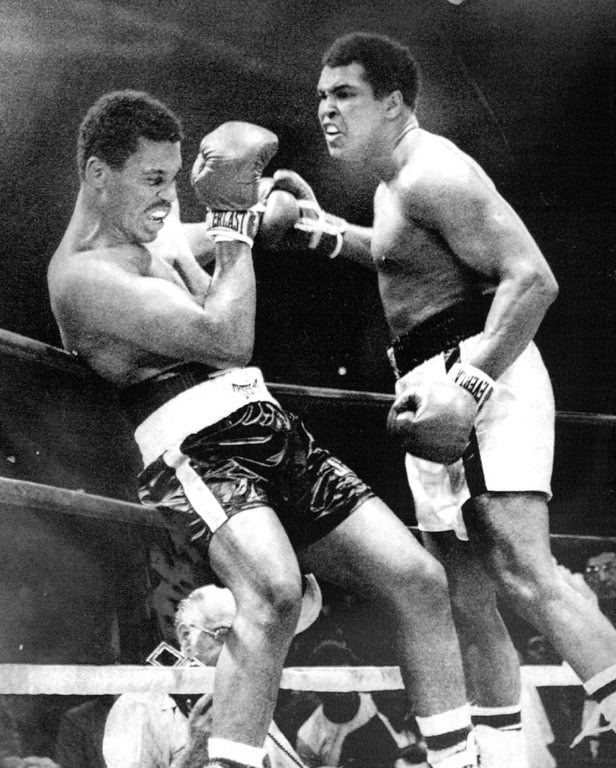 . No Way Out--Heavyweight Champion Muhammad Ali keeps challenger Jimmy Young up against the ropes during their championship fight at Landover Friday. Ali won a unanimous decision in fifteen rounds. 1976. Credit: AP Wirephoto