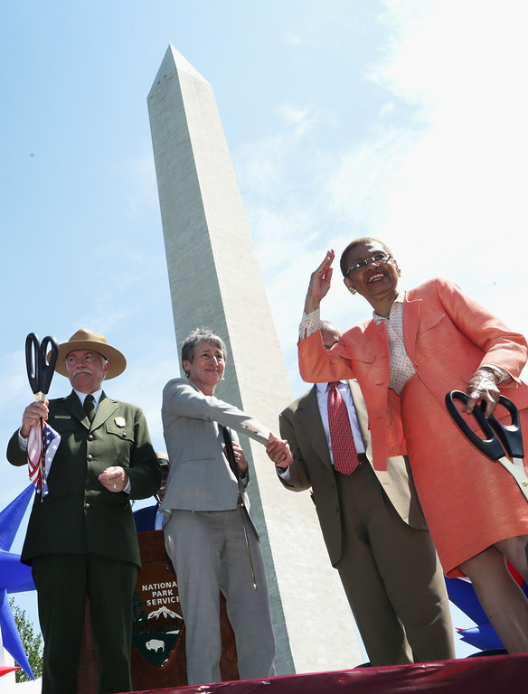 . (L-R) National Park Service Director Jonathan Jarvis, U.S. Interior Secretary Sally Jewell, and Rep. Eleanor Holmes Norton (D-DC) participate in a ribbon cutting during a reopening ceremony for the Washington Monument May 12, 2014 in Washington, DC.  (Photo by Alex Wong/Getty Images)