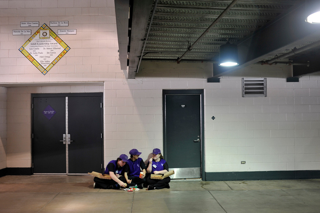 . DENVER, CO. - APRIL 05: Valence Vasquez, 18, Joseph Licano, 17, and Haleigh, Brunot, 18, take a break from working a concession stand at Coors Field. The three teens were working to raise money for the Wheat Ridge High School music program. The Colorado Rockies defeated the San Diego Padres 5-2 in their home opener at Coors Field in Denver, Colorado on Friday, April 5, 2013. (Photo By Patrick Traylor/The Denver Post)