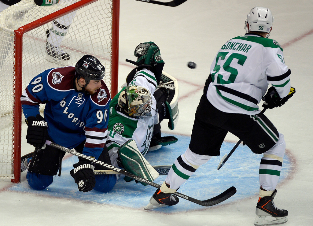 . DENVER, CO - OCTOBER 15: Dallas Stars goalie Dan Ellis (30) makes a glove save after getting tangled up with Colorado Avalanche center Ryan O\'Reilly (90) in the crease during the third period October 15, 2013 at Pepsi Center.(Photo By John Leyba/The Denver Post)