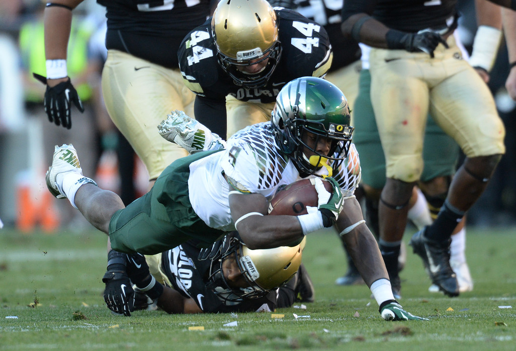 . RB Byron Marshall of University of Oregon (9) dives for the first down in the 2nd quarter against University of Colorado at Folsom Field. Boulder, Colorado. October 5, 2013. (Photo by Hyoung Chang/The Denver Post)
