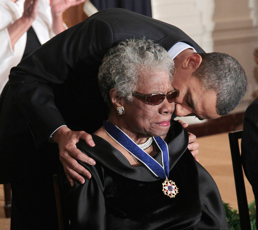 ". In this Feb. 15, 2011 file photo, President Barack Obama kisses author and poet Maya Angelou after awarding her the 2010 Medal of Freedom during a ceremony in the East Room of the White House in Washington. Angelou, author of ""I Know Why the Caged Bird Sings,\"" has died, Wake Forest University said Wednesday, May 28, 2014.  She was 86. (AP Photo/Pablo Martinez Monsivais, File)"