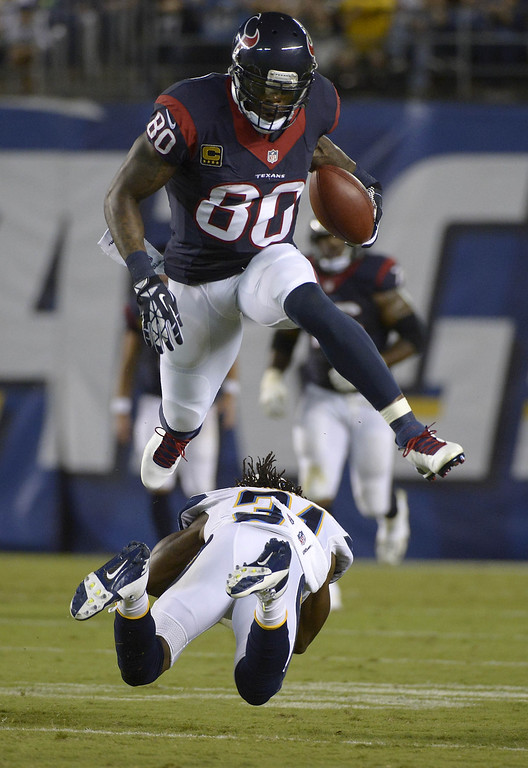 . Andre Johnson #80 of the Houston Texans jumps over Richard Marshall #31 of the San Diego Chargers on September 9, 2013 at Qualcomm Stadium in San Diego, California.  (Photo by Donald Miralle/Getty Images)