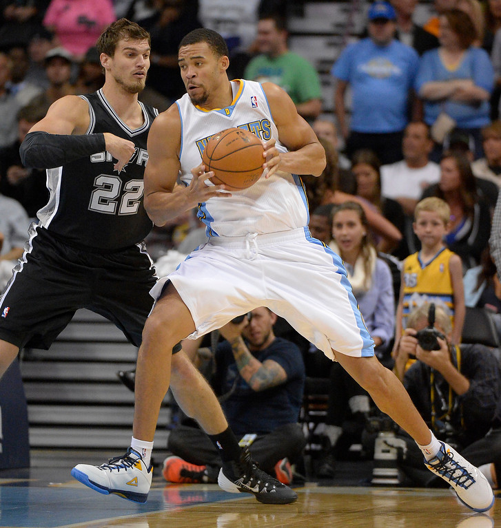 . Denver Nuggets center JaVale McGee (34) puts a spin move on San Antonio Spurs power forward Tiago Splitter (22) during the first quarter October 14, 2013 at Pepsi Center. (Photo By John Leyba/The Denver Post)