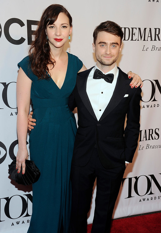 . Daniel Radcliffe, right, and Erin Darke arrive at the 68th annual Tony Awards at Radio City Music Hall on Sunday, June 8, 2014, in New York. (Photo by Charles Sykes/Invision/AP)