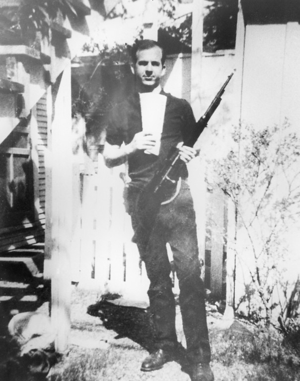 . This photo of Oswald holding a Carcano rifle in his backyard at 214 Neeley St. in Dallas was among evidence gathered by police. Dallas Police Department via Dallas Morning News