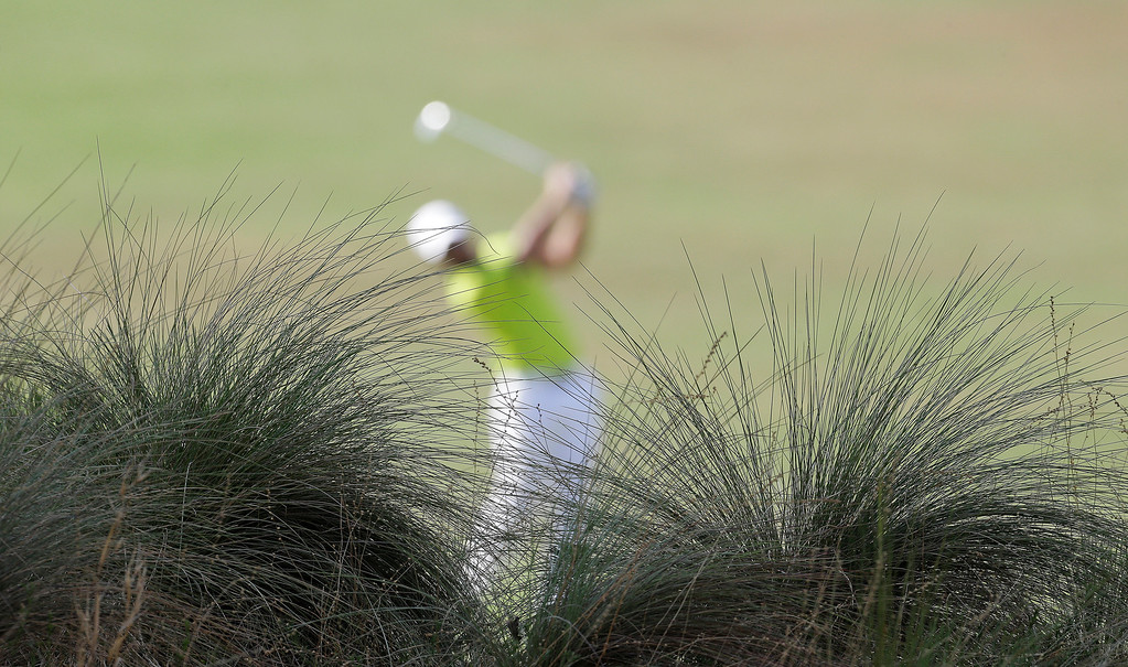 . Paul Casey, of England, hits from the fairway on the eighth hole during the first round of the U.S. Open golf tournament in Pinehurst, N.C., Thursday, June 12, 2014. (AP Photo/Eric Gay)