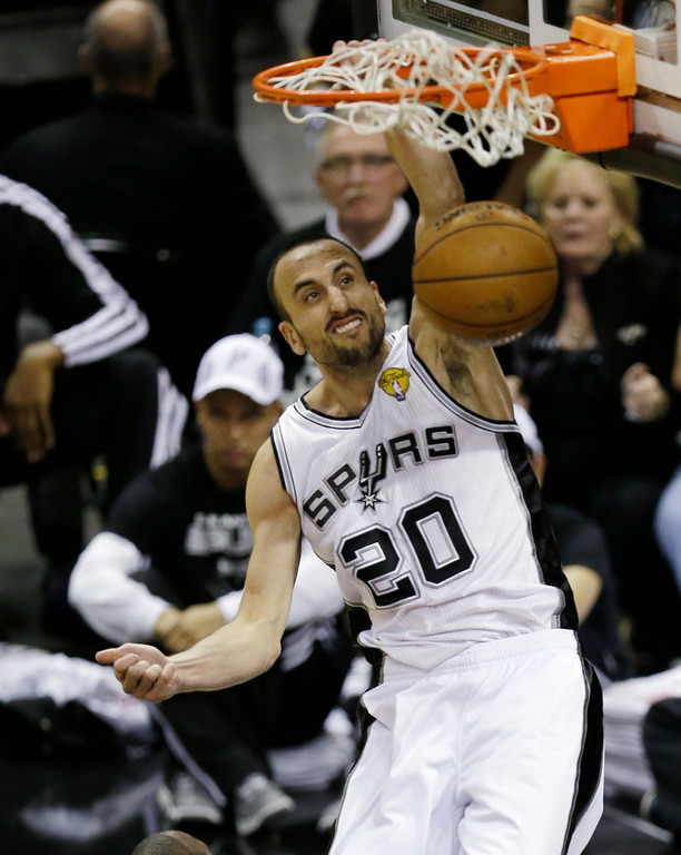 . San Antonio Spurs\' Manu Ginobili (20), of Argentina, dunks during the second half at Game 3 of the NBA Finals basketball series against the Miami Heat, Tuesday, June 11, 2013, in San Antonio. (AP Photo/David J. Phillip)